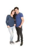 Jeunes couples habillés dans des vêtements bleus Photo libre de droits