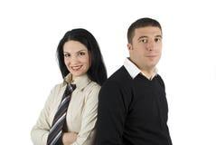 Jeunes couples heureux d'affaires Photos libres de droits