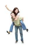 Jeunes couples heureux dans des jeans Images libres de droits