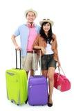 Jeunes couples heureux partant en vacances Photographie stock libre de droits