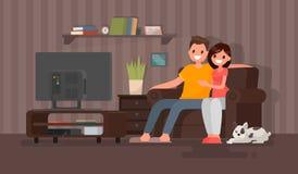 Jeunes couples observant un film L'homme et la femme s'asseyent dessus contre Images libres de droits