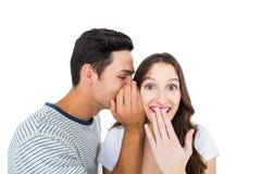 Jeunes couples partageant un secret Images libres de droits