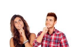 Jeunes couples réfléchis dans l'amour photographie stock libre de droits
