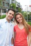 Jeunes couples riant de l'appareil-photo Photos libres de droits