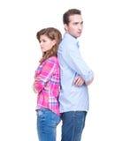 Jeunes couples se tenant de nouveau au dos. Photographie stock libre de droits
