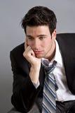 jeunes déprimés d'homme d'affaires Images stock