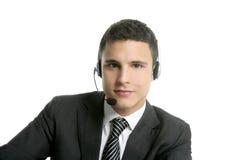 Jeunes d'homme d'affaires avec la verticale d'écouteurs Images libres de droits