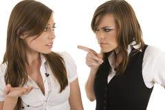 Jeunes dames d'affaires agissant l'un sur l'autre Image stock