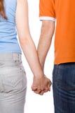 Jeunes dans des mains de fixation de couples d'amour Photographie stock libre de droits