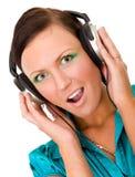 jeunes de femme d'écouteurs photo stock