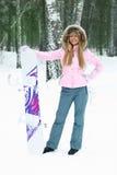 jeunes de femme de snowboard Images stock