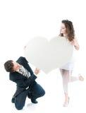 jeunes de forme de fixation de coeur de couples Photos libres de droits