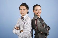 jeunes de sourire de gens de paires d'affaires Photographie stock libre de droits