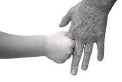 Jeunes et vieilles mains de fixation Photographie stock libre de droits