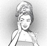 Jeunes femmes dans une serviette principale Image stock