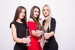 Jeunes femmes de sourire célébrant avec les verres vides sur la partie Images libres de droits