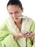 Jeunes femmes malades avec des drogues Images stock