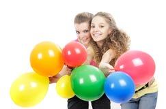Jeunes filles avec des ballons au-dessus de blanc Photos stock