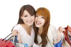 Jeunes filles avec des sacs à provisions Photographie stock libre de droits