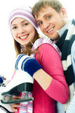 jeunes heureux allants de patinage de glace de couples Photos libres de droits