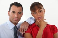 Jeunes homme d'affaires et femme d'affaires Photographie stock