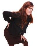 Jeunes inférieurs b de fille d'osteochondrosis de douleur de blessure femelle arrière de femme Photos libres de droits