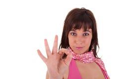 Jeunes jolis femmes avec l'ok de pouce Photo stock