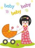 Jeunes mère et chéri dans la poussette sur la promenade Image stock