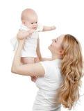 Jeunes mère et chéri heureuses dans des ses mains image libre de droits
