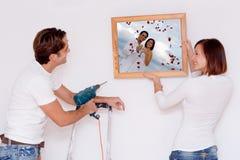 jeunes neufs d'améliorations de l'habitat de couples image libre de droits