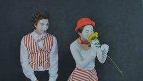 Jeunes pantomimes avec la fleur Photo libre de droits