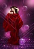 jeunes rouges de fille de robe images stock