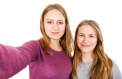 Jeunes soeurs heureuses Image libre de droits