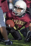 Jeunesse de football américain Images libres de droits