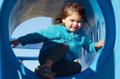 Petite fille dans le terrain de jeu Image libre de droits