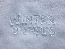 Jeux Olympiques d'hiver - écriture de neige Photos libres de droits