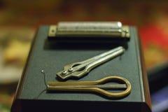 jew& étnico x27 de los instrumentos musicales; arpa y armónica de s Imagen de archivo