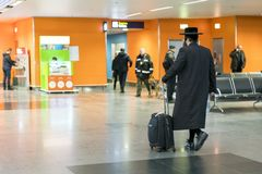 Jew orthodox with a suitcase is going around the airport.  Stock Image