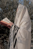 Pray prayerbook and blowing the shofar of Rosh Hashanah Stock Photo