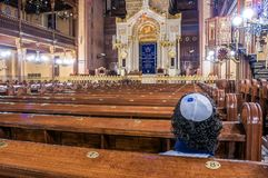 Interior of the Dohány Street Synagogue, Budapest. A Jew prays with the kippah in the interior of the Dohány Street Synagogue, Budapest Stock Images