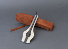 Jew`s harp with wooden case on grey background. Stock Photo