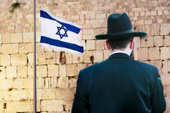 Jew on the wailing western wall background. Rare view of jew on the wailing western wall background, jerusalem, israel Stock Photos