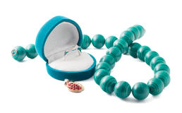 Jewel box with ring and beads Royalty Free Stock Photos