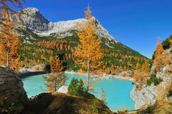 Jewel of the Dolomite Alps. Beautiful little and colorful lake in the Dolomite Alps on a sunny day in autumn. The name of the special lake is Lago Sorapis Stock Images