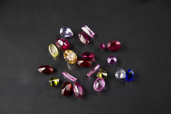 Jewel or gems on black shine color, Studio shot of beautiful gem Royalty Free Stock Image