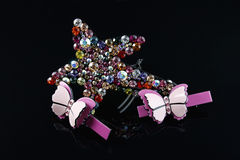 Jewel hairpin and pink bow hairpin Royalty Free Stock Photo