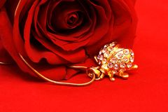 Jewel Ladybug and Rose. Jewelry Ladybug and Red Rose Still Life Stock Photography