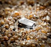 The jewel lies on  sand. Royalty Free Stock Images