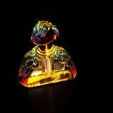 Jewel-like glass perfume bottle over black Stock Image