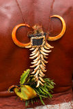 Jewel ornament from Papua. Bone traditional jewel from Papua. Horn shaped pattern to a background of red skin Stock Photography